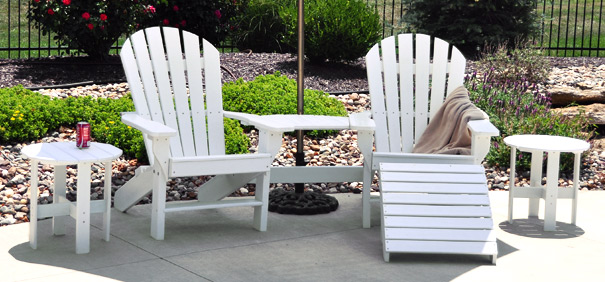Seaside Adirondack Chairs Joined by a Tete-A-Tete Shown with Two Side Tables